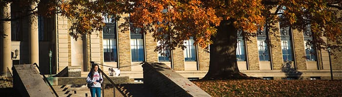 Student walking down the front steps of Baker Laboratory