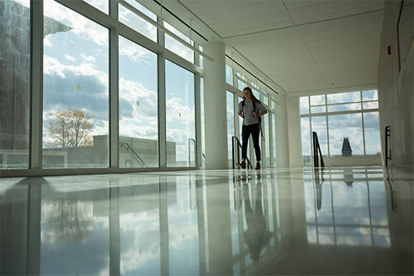 Student Walking through the Hallway